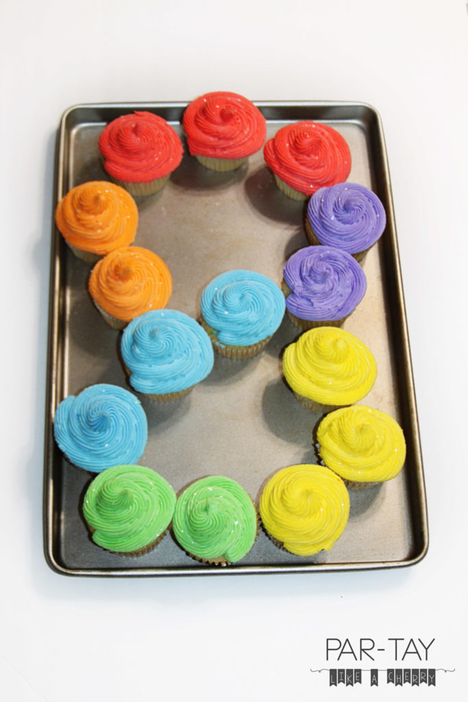 8 year old birthday or baptism dessert idea, rainbow cupcakes in the shape of an 8