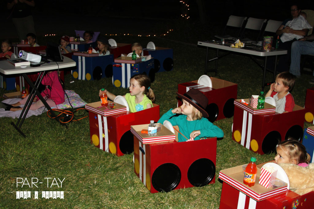 watcing the movie in their cardboard box cars